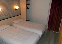 卡昂番紅花紀念酒店 - 康城 - 康市 - 臥室