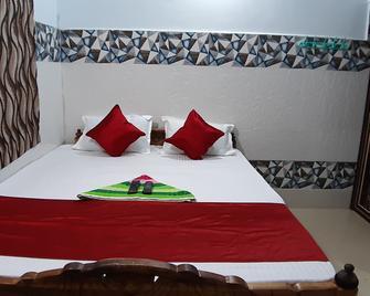 Goroomgo Glory Puri - Puri - Habitación