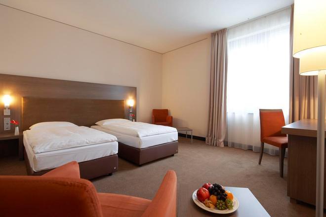 Intercityhotel Dresden - Дрезден - Спальня