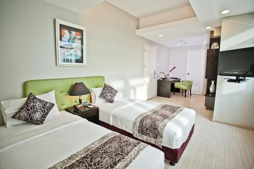 The Exchange Regency Residence Hotel - Manila - Bedroom