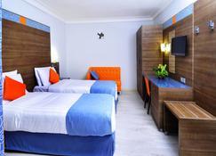 Bénin Royal Hôtel - Cotonou - Schlafzimmer
