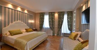 هوتل سافويا آند جولاندا - البندقية - غرفة نوم